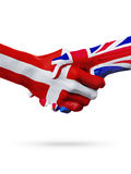 Flags Denmark, United Kingdom countries, partnership friendship handshake concept. Royalty Free Stock Image