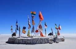 Flags in desert of Uyuni. Flags on the Salar de Uyuni, Bolivia royalty free stock image