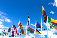 Flags of the different countries against sky. Lourdes, France Royalty Free Stock Photography