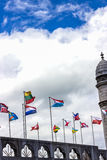 Flags of different countries against the sky. Lourdes, France, Hautes Pyrenees Royalty Free Stock Photo
