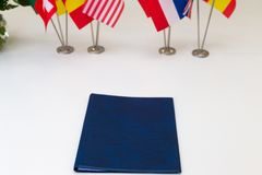 Flags of different countries on the background of the white tabl royalty free stock photo