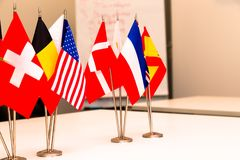 Flags of different countries on the background of the white tabl stock photos