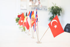 Flags of different countries on the background of the white tabl Stock Photography