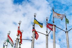 Flags of different countries on blue sky background Stock Images