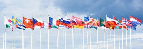 Flags of different countries. On high flagpoles royalty free stock images