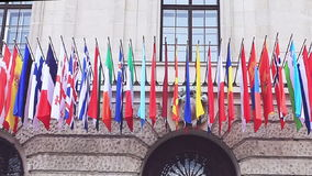 Flags of different countries of the international community, summit in Vienna stock footage