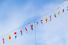 Flags of different countries on the mast Stock Photos