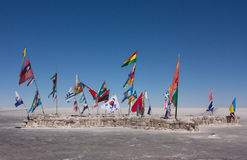 Flags of the different countries on the saline land Salar de Uyuni in Bolivia. Flags of the different countries against the background of the sky on the saline Stock Photography