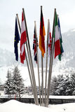 Flags of different nations in the snow Stock Image