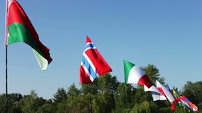 Flags of different states sway on wind.Lots of flags of different countries fluttering in the wind. Flags of different states sway in the wind.Lots of flags of stock footage