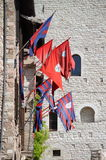Flags of districts in the medieval town of Assisi Stock Photo