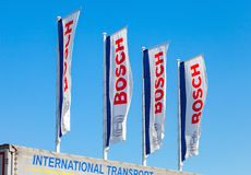 Flags with emblem Bosch against the blue sky Stock Images
