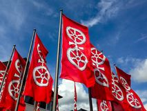 Flags with the emblem of the city of Mainz. With blue sky in the background Royalty Free Stock Photo