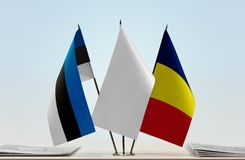 Flags of Estonia and Chad. Desktop flags of Estonia and Chad with white flag in the middle royalty free stock image