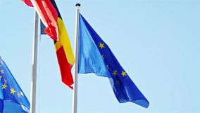Flags of EU, Belgium, Bulgaria waving in front of Parliament, Strasbourg Royalty Free Stock Photography