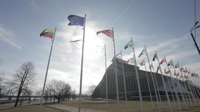 Flags of EU countries infront of New Building of National Library of Latvia stock video