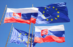 Flags of EU and Slovakia Stock Photo