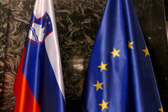 Flags of EU and Slovenia stock photography