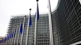 Flags of EU waving in wind near European Parliament stock video