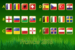 Flags of Euro 2016 on grass background and soccer ball. 24 nations. Vector icons Royalty Free Stock Photography