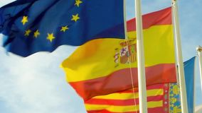 Flags of Europe and Spain. Flapping in the breeze stock footage