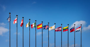 Flags of the European countries against the blue sky. National flags of the European countries against the blue sky Stock Photo