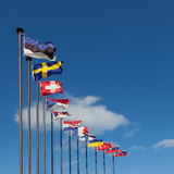 Flags of the European countries against the blue sky. National flags of the European countries against the blue sky stock images