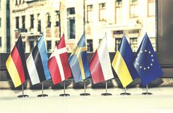 European Union, flag Europe a country European National sym. Flags of European countries and the flag of the European Union close up at the window in the Stock Photography