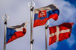 Flags of European countries. On flagpoles against the blue sky royalty free stock image
