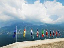 Flags of European countries over Garda lake Stock Image