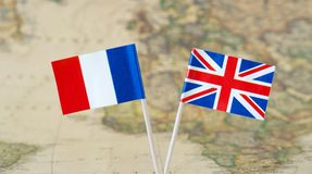 Flag pins of leader countries France and Great Britain UK, concept image Stock Photography