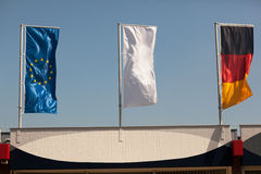 Flags of european union EU, Germany and white flag. For peace or surrender Stock Image