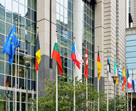 Flags of European Union at European Commission building in Brussels. Flags on front of European Parliament in Brussels royalty free stock images