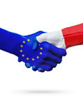 Flags European Union, France countries, partnership friendship handshake concept. Flags European Union, France countries, handshake cooperation, partnership Stock Photos