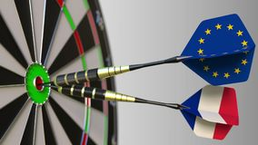 Flags of the European Union and France on darts hitting bullseye of the target. International cooperation or competition. Flags of the European Union and France Royalty Free Stock Photo
