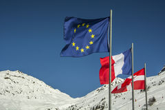 Flags of European Union and  France in the french Alps. Royalty Free Stock Photo