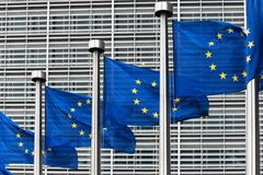 Flags of the European Union. In front of the Berlaymont building in Brussels, Belgium Royalty Free Stock Image