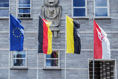 Flags of the European Union, Germany,Saxony-Anhalt, and g.Halle. Opposite the Town Halle, g.Halle, Germany, 06/27/2016 Stock Images
