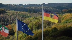 Flags of European Union and Germany waving on wind mountains. Stock footage stock video