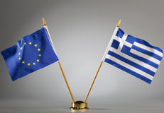 Flags of European Union and Greece. EU and Greek flag on a grey background (with center spot light on the background Stock Photo
