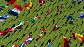 Flags of the European Union on green field. stock footage