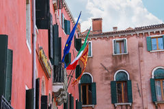Flags of the European Union, Italy and Venice on a facade the h Stock Images