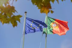 Flags of the european union and portugal Royalty Free Stock Photos
