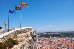 Flags of European Union, Portuguese flag and Nazare Flag with Na. Flags of European Union, Portuguese flag and Nazare Flag on Miradouro do Suberco with Nazare Royalty Free Stock Photo