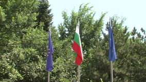 Flags of the European Union, and the resort of Varna in the resort of Golden Sands, Bulgaria. Varna - the sea capital of Bulgaria, a center of shipping and stock footage