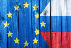 Flags of the European Union and Russia. On the background of the old wooden texture Stock Photography