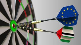 Flags of the European Union and the UAE on darts hitting bullseye of the target. International cooperation or. Competition animation stock video