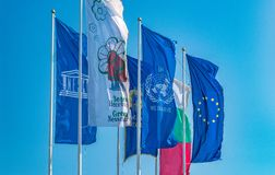The Flags of European Union, United Nations, Unesco, Bulgaria, and Nessebar city waving in the wind. EU, UN, Unesco, Bulgaria, and stock photo