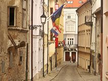 Flags in the alley. Flags. Flags on the facades of houses in the streets of Bratislava. Scenes old architecture royalty free stock photography