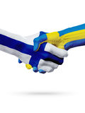 Flags Finland, Sweden countries, partnership friendship handshake concept. Royalty Free Stock Photos